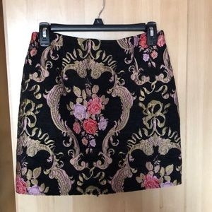 A flower embroidered mini skirt